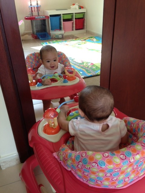 Is there another baby in the mirror?